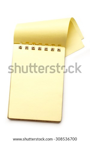 Yellow blank notepad with open page closeup - stock photo
