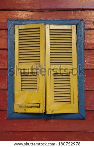 Yellow blue red old painted colorful window, At Buenos Aires, Argentina. 03/28/2010 - stock photo