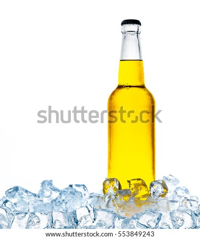 Yellow bottle of refreshing drink on ice cubes.