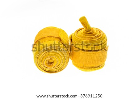 Yellow boxing or MMA hand wraps or bandages isolated on white - stock photo