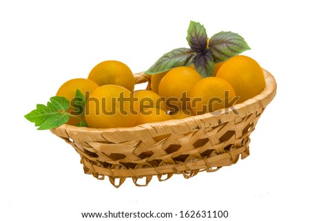 Yellow bright cherry tomato with leaf