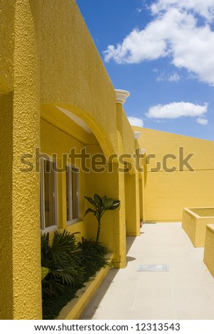 yellow building, blue sky