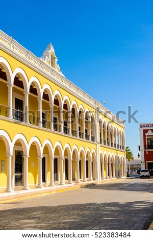 Yellow building of the main square (Zocalo) of Palenque, Mexico.