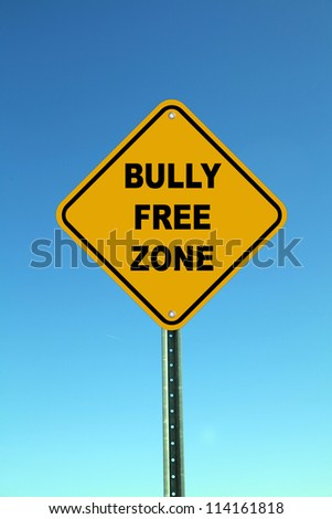 Yellow bully free zone road sign on bright blue sky background - stock photo