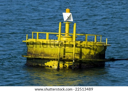 Yellow buoy on a blue water - stock photo