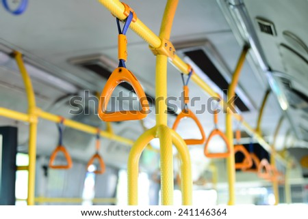 yellow bus handle - stock photo