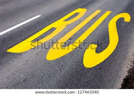 Yellow bus sign on the road - stock photo