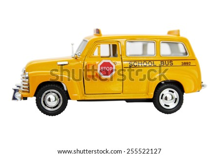 Yellow bus toy isolated on white background