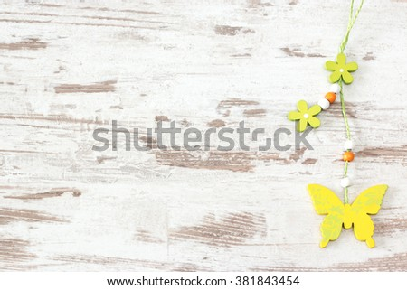 Yellow butterfly of wood on bright wooden background