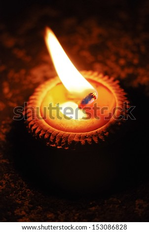 Yellow candle in terracotta pot lit on the occasion of Loy Krathong festival, Thailand - stock photo