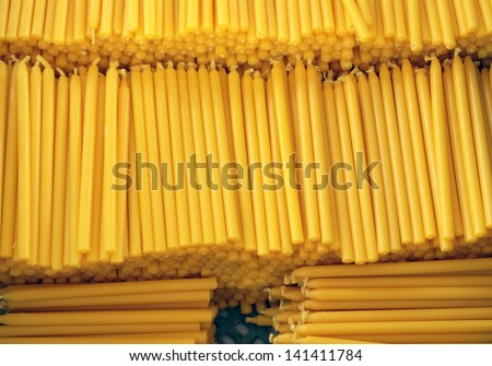 Yellow candles. - stock photo