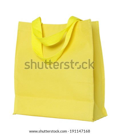 yellow canvas shopping bag isolated on white background with clipping path - stock photo