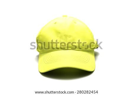 yellow cap isolated on white background - stock photo