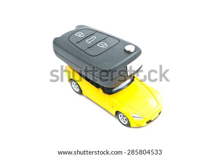 yellow car and car keys on white background