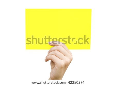 Yellow card in a hand against the white background