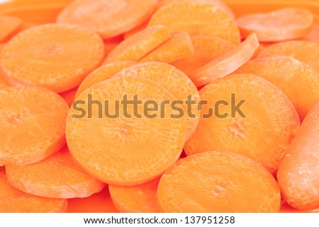 Yellow carrots, cut into pieces put together. - stock photo