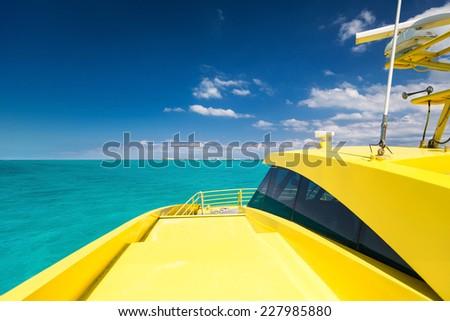 Yellow catamaran in caribbean sea, Cancun, Mexico  - stock photo