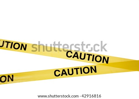 Yellow caution tape on a white background with copy space - stock photo