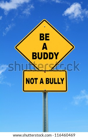 Yellow Cautionary road sign, Be A Buddy, Not a Bully on a blue sky background