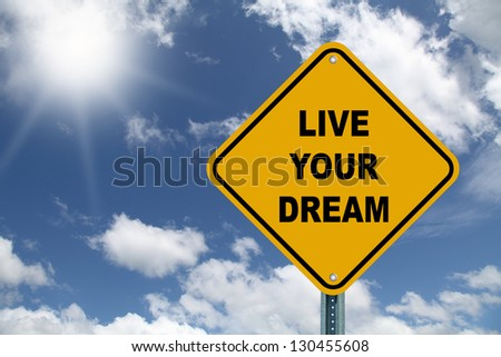 Yellow cautionary road sign Live Your Dream - stock photo