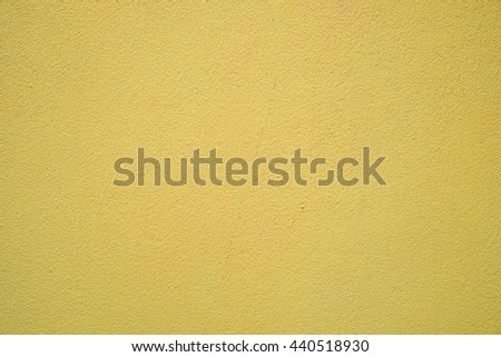 Yellow cement or concrete wall texture and background - stock photo