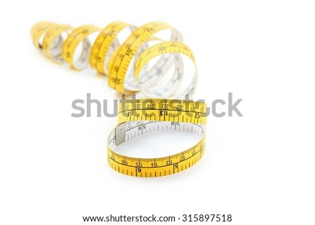 Yellow centimeter and inch tape measure on white background. - stock photo