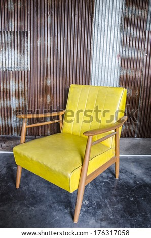 Yellow chair and zinc wall - stock photo