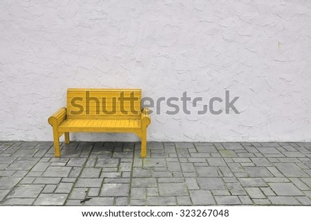 yellow chair on white background,yellow chair wooden on white wall - stock photo