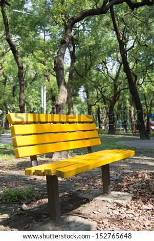 yellow chair with green walkway