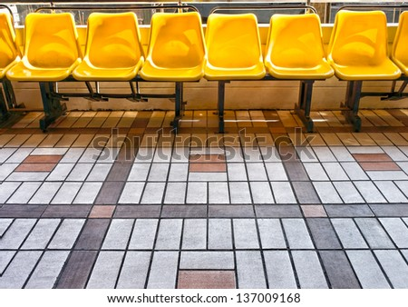 Yellow chairs in walkway side - stock photo