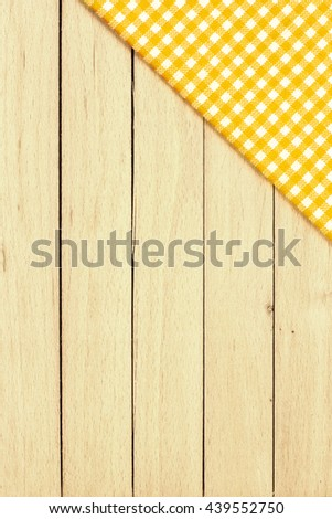 Yellow Checkered Tablecloth On The Table