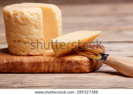 yellow cheese on board - stock photo