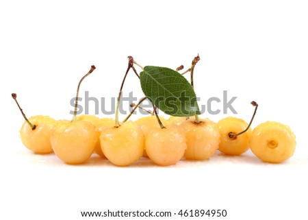 Yellow cherries and leaf