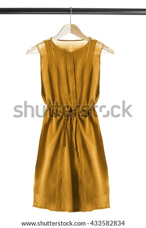 Yellow chiffon dress on wooden clothes rack isolated over white - stock photo