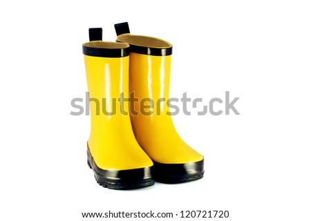 Yellow children`s boots - stock photo