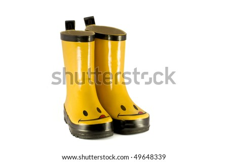 Yellow children`s boots isolated on white - stock photo