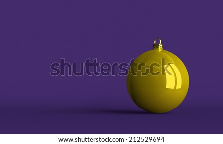 Yellow Christmas ball on violet textured background