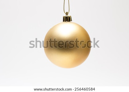 Yellow christmas decoration ball isolated on white - stock photo