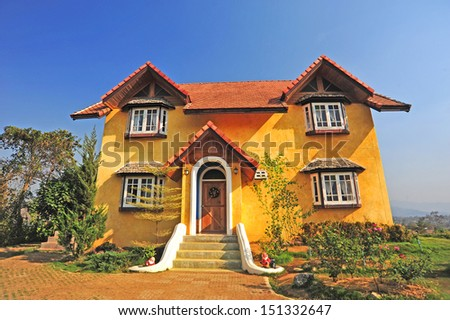 Yellow classic house on hill, pai, maehongson, thailand
