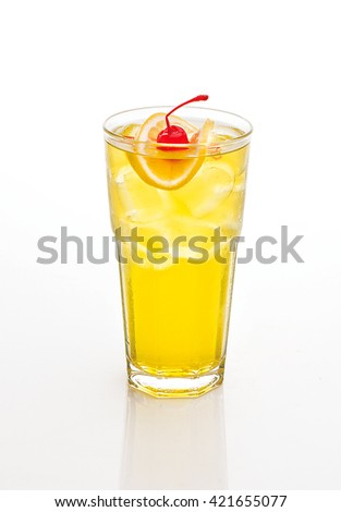 yellow cocktail decorated with cherry and lemon isolated on white.