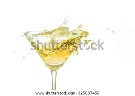 Yellow cocktail splash on white background close up. - stock photo