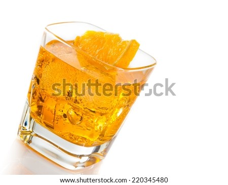 yellow cocktail tilted with orange slice isolated on white background with space for text