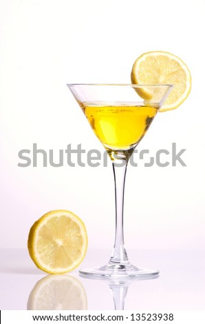 Yellow cocktail  with lemon on white background