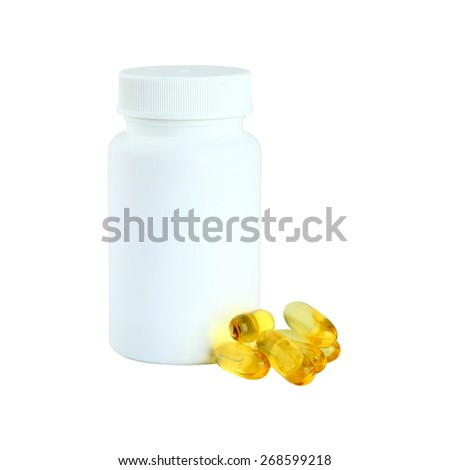 Yellow Cod Liver oil omega 3 gel capsules next to a bottle on white background - stock photo