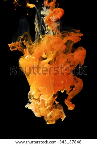 Yellow color ink paint abstract pattern in water liquid - stock photo