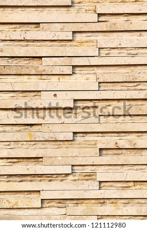 Yellow color stone wall texture - stock photo