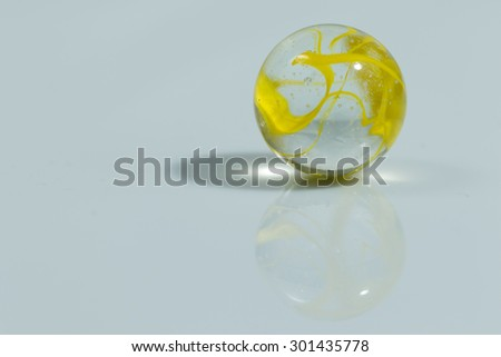 Yellow Colorful Marble Ball on white background - stock photo