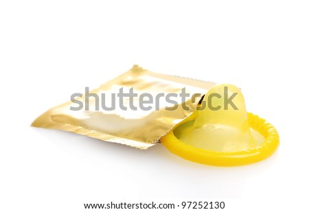 Yellow condom with  open pack isolated on white - stock photo
