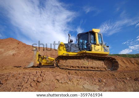 Yellow Construction bulldozer at Work - stock photo