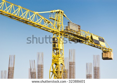 yellow construction crane on blue sky